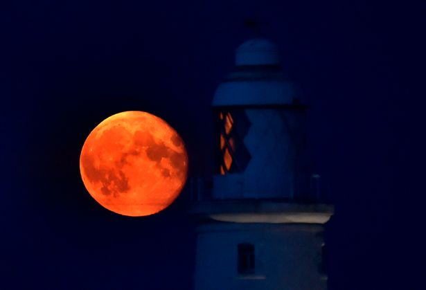 A Harvest Moon in 2014 at St Mary's Lighthouse, near Whitley Bay, North Tyneside. Both the Harvest Moon and the subsequent Hunter's Moon can take on an eerie orange hue. Picture: Owen Humphreys/PA Wire